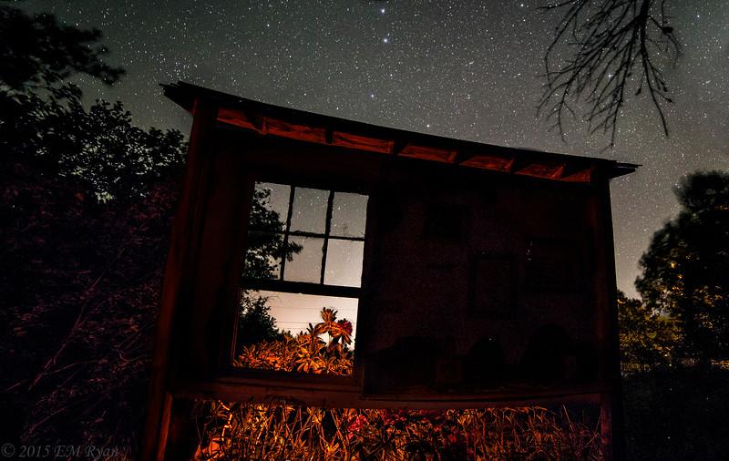 Window with stars and fireflies