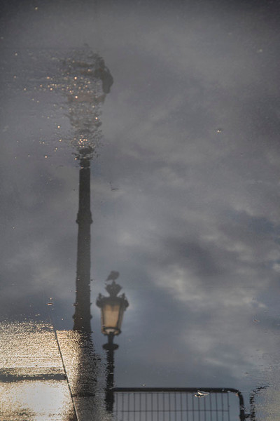 © 2013 Anne Henning  - Paris puddles outside Cafe Marly