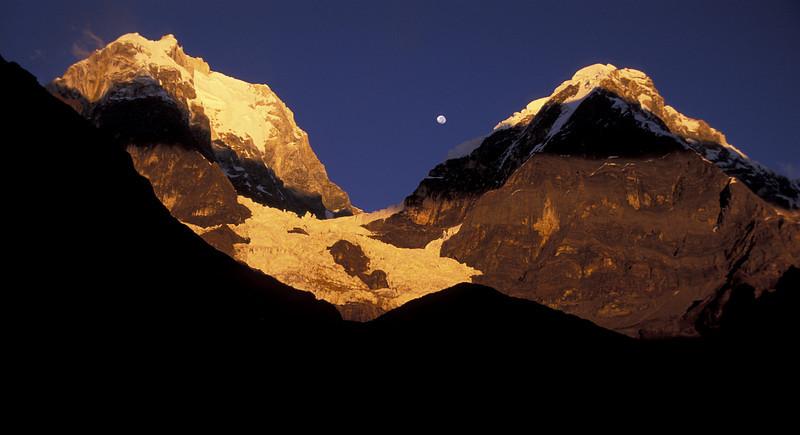 Moon over Peru <br /> The golden morning sun baths light on Peru's second highest peak, Yerupaja.