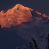 Early sun on Mt. Baker, from Artist Point <br /> The northern-most volcano in the Cascade Range, Mt. Baker is skirted with gentle, undulating glaciers around its symmetrical base. This photograph was shot on a cold, clear March morning from my tent on Artist Point.