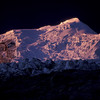 Huascaran Peak, Peru <br /> Clad in Ice and Granite the highest mountain in Peru is Nevado Huascaran. The summit is a strange juxtaposition of extreme environments. To the east is the Amazon rain forest. Westward you look on one of the driest deserts in the world stretching right to the Pacific Ocean. On top, you're standing on a storm battered 22,200' foot ice-covered summit.