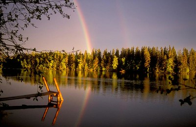 Rainbow and boat dock, Finland.