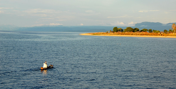 Canoe on Lake Malawi approaching Cobue village, Mozambique.