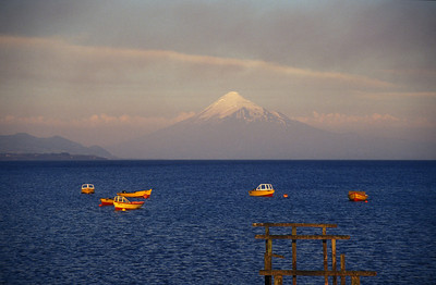 Boats on Llanquihue Lake and Mt. Osorno, the lakes region of Chile.