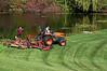 Kubota L4240 tractor pulling a Progressive mower deck