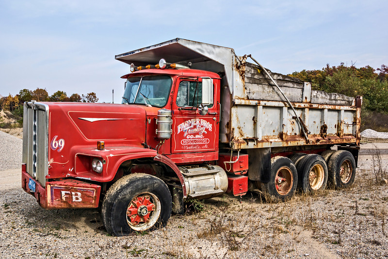 D302-2013  Old Diamond Reo dump truck, model year unknown, but possibly late 1960's or early 1970's.<br /> Help pinning down the model year would be appreciated.  I'm pretty ignorant about old trucks.<br /> <br /> Seen at an old sand and gravel quarry in southeast Michigan.  Last registered, based on license plate and window sticker either 1995 or 1996.