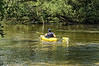 Serious kayaker on the Huron River just below the Kent Lake Dam.<br /> <br /> Michigan<br /> August 1, 2013