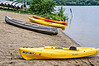 D183-2013  Canoes and kayaks launch from this shallow sand beach rather than from the dock with the paddleboats.<br /> .<br /> Kent Lake, Kensington Metropark, Michigan<br /> July 2, 2013