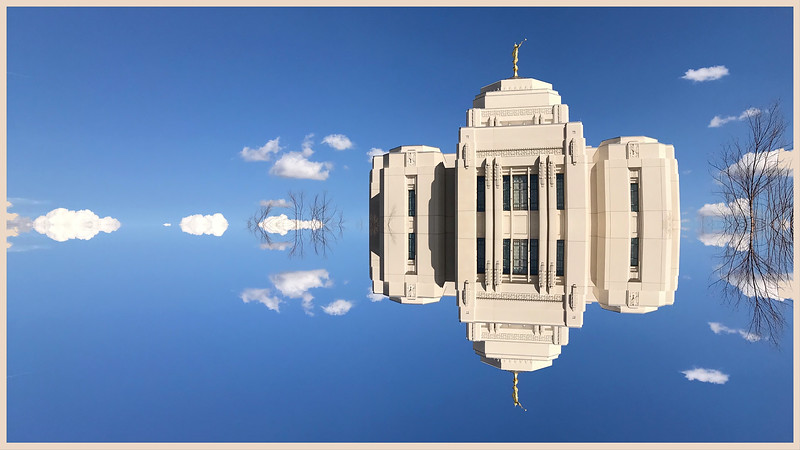 "Sometimes the simplest image transformations yield interesting pictures.  Here I've used the mirror symmetry feature in Photoshop Express to reflect parts of an iPhone shot of a nearby Mormon temple. The result is oddly appropriate:  a sky fairy castle untethered from reality. The ease with which we transmogrify pixels is rapidly degrading the artistic value of photography. Genuine art requires substantial discipline and pain! Anything that is easily achieved is almost by definition worthless. Thirty years ago creating an image like this would have required vision, preparation, planning and technical skills.  Today it requires pushing a few buttons. The art has been obliterated by technology. You can argue otherwise but you will quickly encounter the Jackson Pollock problem.  Throwing paint on canvas requires little discipline or pain.  The result may be visually arresting but if it's ""art"" so is this silly reflection."