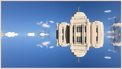 """Sometimes the simplest image transformations yield interesting pictures.  Here I've used the mirror symmetry feature in Photoshop Express to reflect parts of an iPhone shot of a nearby Mormon temple. The result is oddly appropriate:  a sky fairy castle untethered from reality. The ease with which we transmogrify pixels is rapidly degrading the artistic value of photography. Genuine art requires substantial discipline and pain! Anything that is easily achieved is almost by definition worthless. Thirty years ago creating an image like this would have required vision, preparation, planning and technical skills.  Today it requires pushing a few buttons. The art has been obliterated by technology. You can argue otherwise but you will quickly encounter the Jackson Pollock problem.  Throwing paint on canvas requires little discipline or pain.  The result may be visually arresting but if it's """"art"""" so is this silly reflection."""