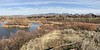 iPhone panoramas have their charms. This one is looking north over Hyatt Hidden Lakes Reserve park in Boise. The communication towers on the mountains in the distance are visible in the larger sizes.
