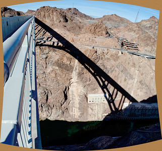 I leaned over the pedestrian railing of the new Interstate bridge south of the Hoover dam to squeeze off the frames that went into this panorama of the bridge's shadow on the canyon walls.