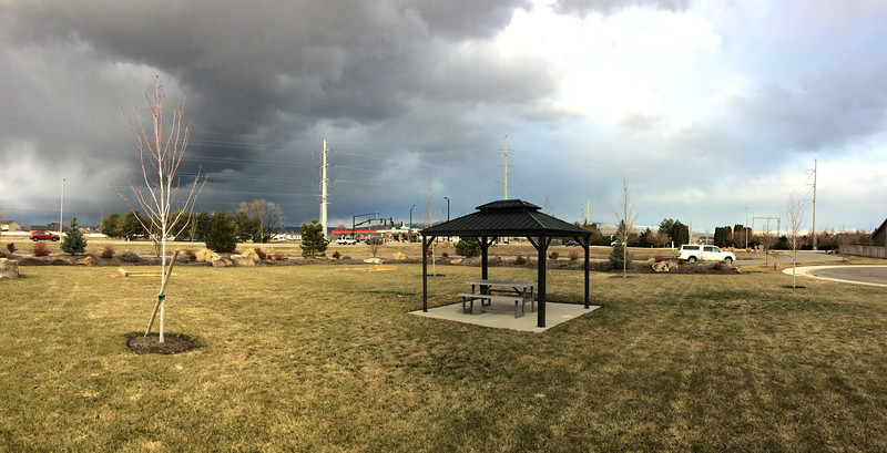 Dark clouds and low side light gives this mundane nearby park a quality it lacks in better weather.