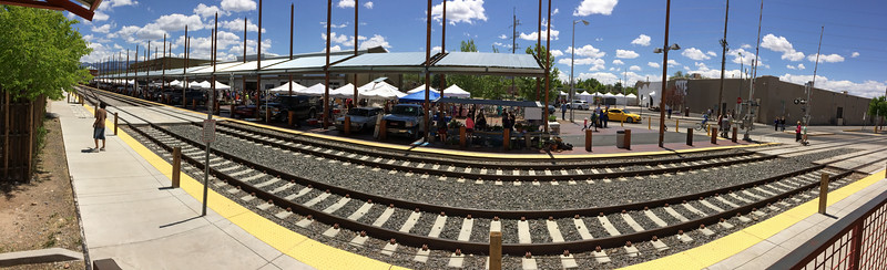 An iPhone panorama of the Santa Fe railyard and farmers market. Track curvature is an artifact of the panorama software. On some subjects the distortion has a beneficial impact on the image.