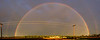 A dramatic sunset rainbow over the field to the east of our apartment.  I was in my underwear when I spotted the bow but that didn't stop me from grabbing a camera and rushing outside in the drizzle to snap enough frames to build a panorama.
