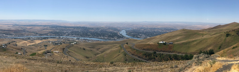 Looking west over Lewiston Idaho from a scenic highway overlook.  The Clearwater river merges with the Snake which then turns west and flows into Washington where it dumps into the Columbia.