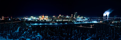 "I'm happier with some panoramas than others. I find this one particularly pleasing. One of the things I most enjoyed about Edmonton's cold winters was walking around at night when it was -30C or colder. The cold drove most people indoors leaving the streets deserted and silent. I probably shot the two Ektachrome slides that went into this panorama on such a night. The original slides had tilted horizons, I almost certainly braced the camera on something to make the long exposures, and there was very little overlap. My first attempt to stitch the images in Affinity Photo failed. The program told me ""No panorama found.""  I resized and sharpened the images to give the control point location software a better chance at finding matches. It worked like a charm and this shot of downtown Edmonton on a cold winter night of 1971 popped out."