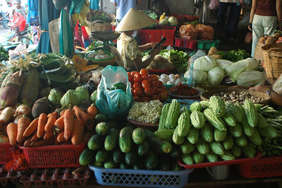 Vendor at the morning produce market, Hoi An, Vietnam.