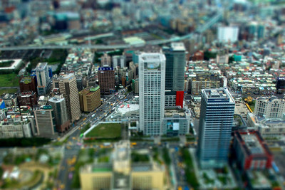 "Was dining at 68th storey of Taipei, and took the opportunity to take a view of the city through the windows. I've converted the city view into a ""miniature"" look-alike using Photoshop. The cars and buildings looks really interesting in miniature."