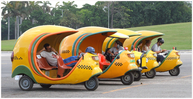 Your Coco Taxi Awaits by John Brooks
