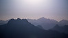 Whatcom, Park Butte - Hazy moonrise over Picket Range with layers of mountains