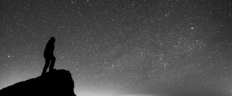 Vantage, Frenchman Coulee - Man on edge of cliff looking at stars, black and white