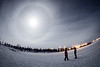 Yellowknife, Long Lake - Two people conversing on a frozen lake under full moon