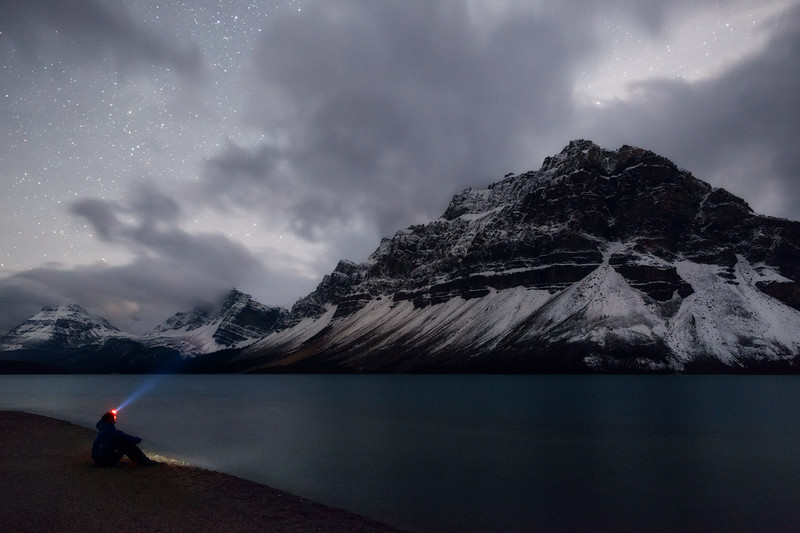 Banff, Bow Lake - Man on beach at night with stars and clouds