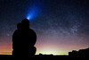 Vantage, Frenchman Coulee - Man sitting on ground watching aurora borealis in the distance