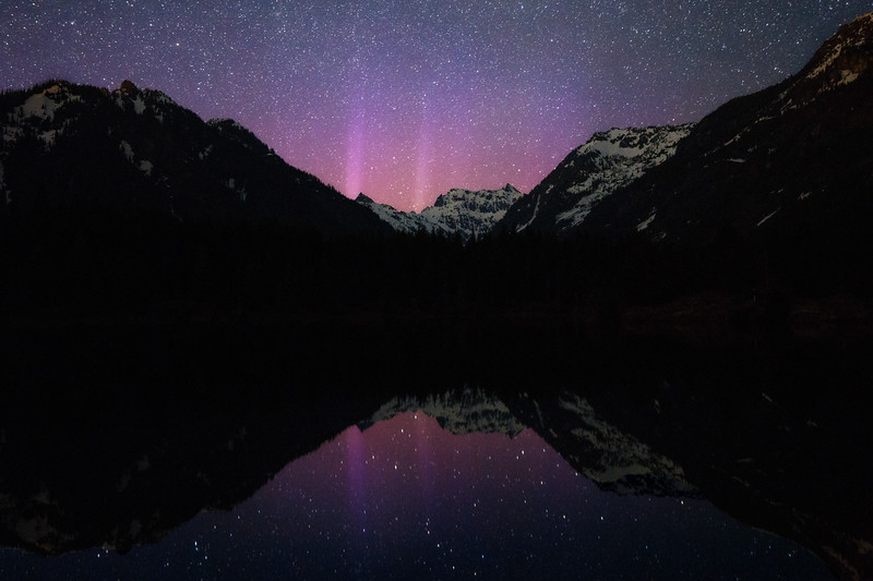 Snoqualmie Pass, Gold Creek Pond - Soft pink aurora over the pond with reflection
