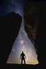 Columbia, Vantage - Climber between two basalt columns looking at Milky Way