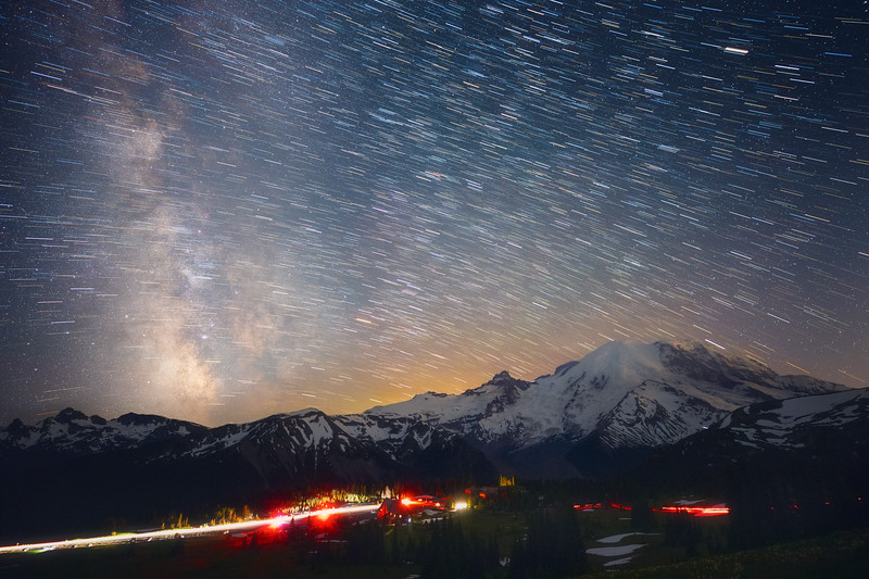 Rainier, Sunrise - Milky Way and star trails above the Sunrise Lodge with cars, headlamps, and climbers