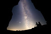 Columbia, Vantage - Photographer in a cave looking up at Milky Way