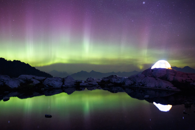Whatcom, Artist Point - Illuminated tent above a lake with strong aurora