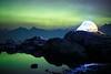 Whatcom, Artist Point - Illuminated tent above a lake with aurora borealis, close up