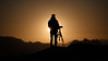 Whatcom, Park Butte - Silhouette of photographer with hazy moonrise over Pickets