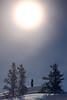 Yellowknife, Vee Lake - Man on snowy hillside under the full moon