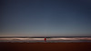 Oregon Coast, Lincoln City - Man on the beach at night watching the stars