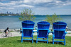 Do chained blue waterfront chairs yearn for freedom?