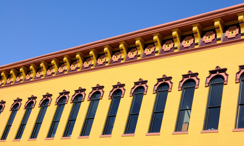 Never underestimate a coat of paint.  This mustard colored building facade in downtown Muncie commanded my attention. I walked around it snapping pictures and getting my fill of mustard in the afternoon sun.