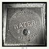 Water meter cover. Sometimes even the dullest of subjects can shine.