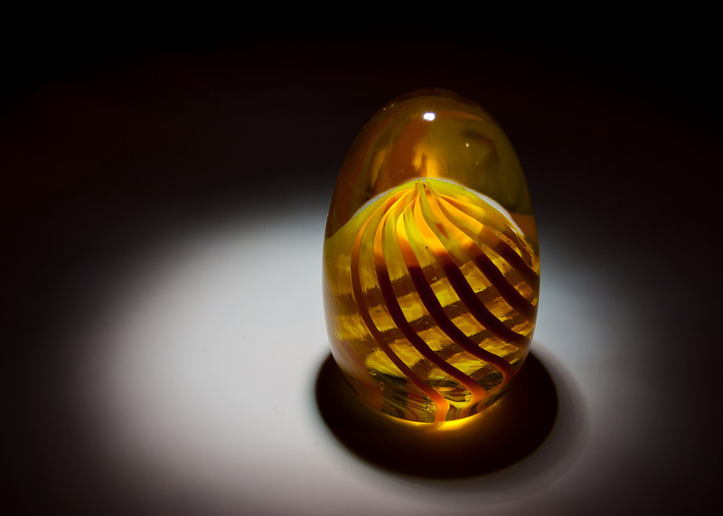Light from above on glass egg.