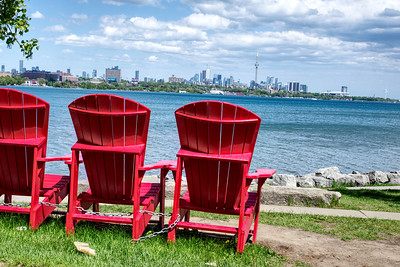 Empty red chairs enjoying the view.