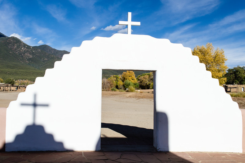 Taos Pueblo church entrance. This building has been victimized by camera-wielding tourists for decades. Still, when shadows conspire, it is hard to resist taking another shot.