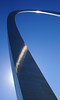 The St. Louis arch is best photographed at a distance.  It's a challenging composition up close but you cannot go very wrong with stainless steel and a clear blue sky.