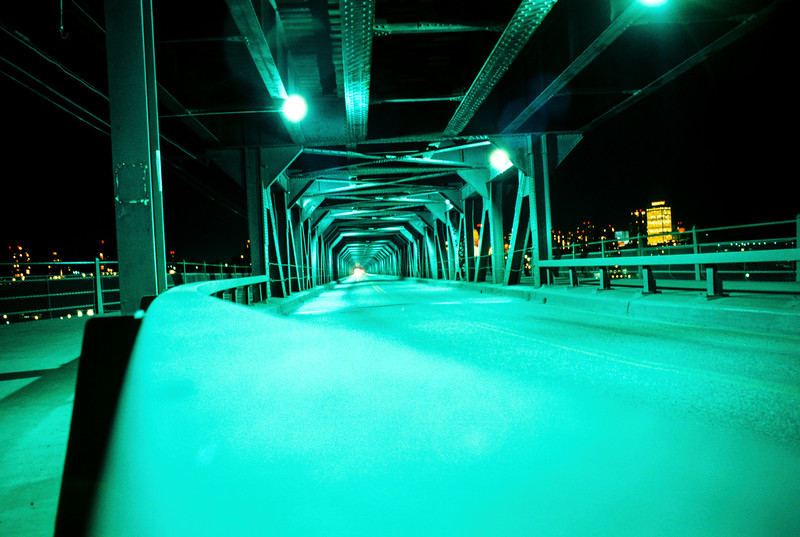 The southern end of the High-Level Bridge in Edmonton. I snapped this slide with an old 35mm rangefinder in 1970 using Ektachrome film. In some ways, time exposures with film were easier than digital shots. Modern digital cameras are far more sensitive than old color slide films. You wouldn't need a very long exposure at high ISO to record this scene digitally. In the 1970s Ektachrome was usually ASA 64 or 100. To get this shot I braced the camera on the bridge road railing and held the shutter open. I can't remember how long the exposure was but it was probably ten to twenty seconds. Film suffered from reciprocity failure which basically means the effective ASA decreases, nonlinearly, with exposure time. At some point, the failure point, the film's ASA is essentially zero. What I like about this shot is the distorted color. When scanning and adjusting this slide I retained the unbalanced color. Daylight films used at night often produced lovely hard to emulate colors.