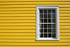 Simple yellow wall and window.