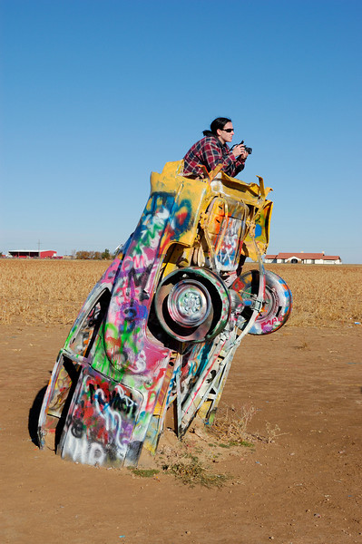 I have been through Amarillo Texas a number of times without checking out the Cadillac Ranch.  When I stopped by while moving east this dedicated young photographer was working hard on her composition.