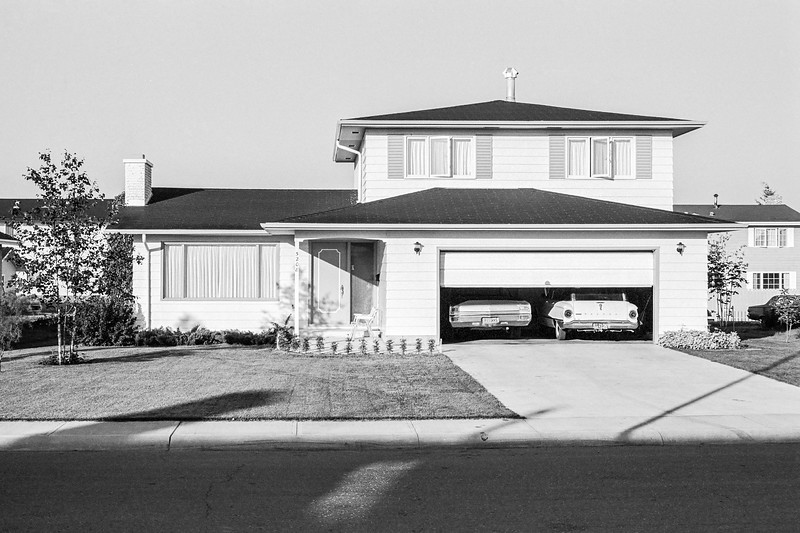 5208 Lansdowne Drive Edmonton Alberta. My family moved into this house shortly after we moved to Canada from Iran in 1969. Sometime in 1970, the photography bug bit me hard. This was partly because some of my friends had access to dark rooms. I started taking black and white 35mm shots, first with an old 35 Signet rangefinder, and then later with my first Minolta 35mm SLR. After shooting I developed my own negatives. I also bought B&W film in bulk, wound my own film canisters, and experimented with various developers and print papers. I shot and developed this picture as a test. I have other shots of this house but this is the best of the lot.