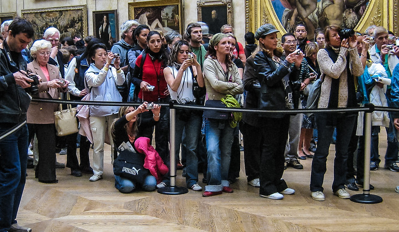 Tourists photgraphing the Mona Lisa, Louvre Museum, Paris, France